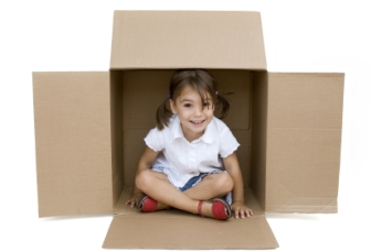 girl-inside-moving-boxes