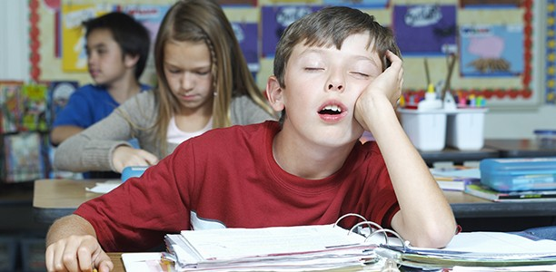 child_boy_sleeping_school_classroom-612x300